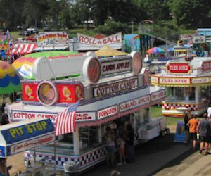 Vendors and the midway at the Afton Fair